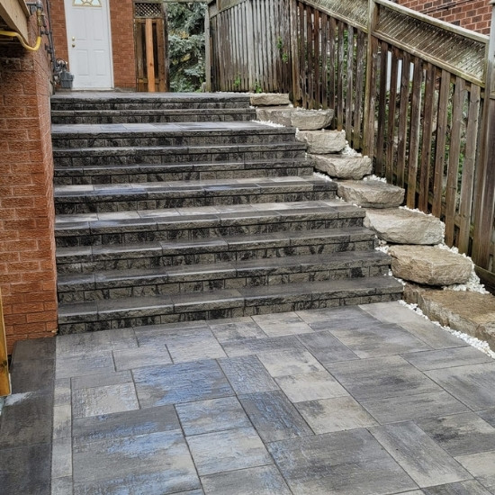 Side of a home with natural stone steps.