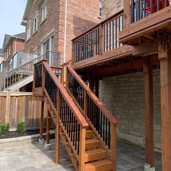 Wooden deck in the backyard of a Toronto home.