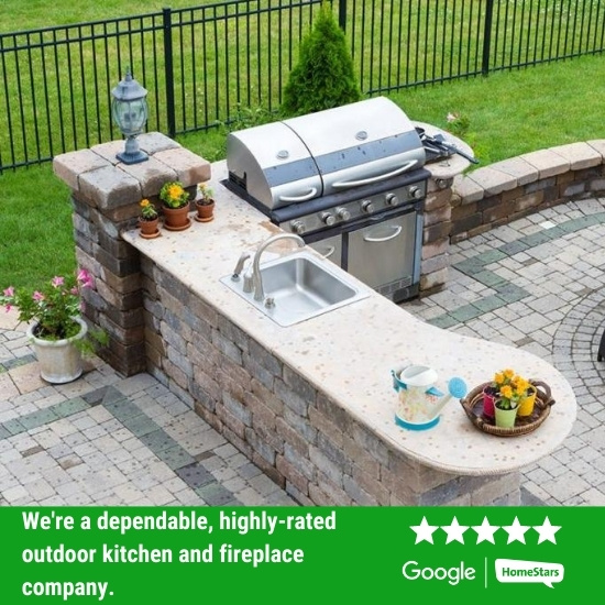 Outdoor kitchen installed in a backyard.