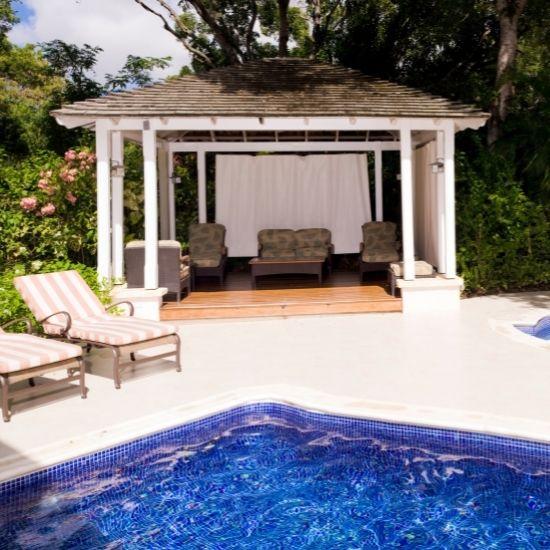 Gazebo beside backyard pool.