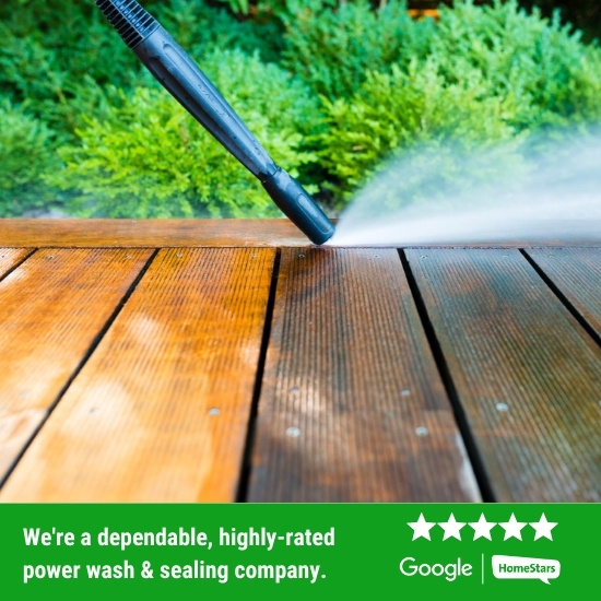 Contractor power washing a deck.