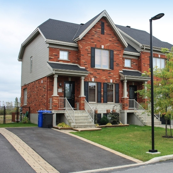 Home with asphalt paved driveway.